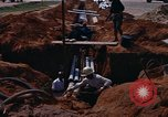 Image of laying pipes Thailand, 1966, second 9 stock footage video 65675042838