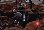 Image of laying pipes Thailand, 1966, second 11 stock footage video 65675042838