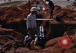 Image of laying pipes Thailand, 1966, second 13 stock footage video 65675042838