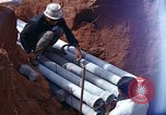 Image of laying pipes Thailand, 1966, second 20 stock footage video 65675042838