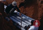 Image of laying pipes Thailand, 1966, second 21 stock footage video 65675042838