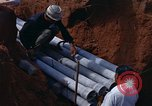 Image of laying pipes Thailand, 1966, second 22 stock footage video 65675042838