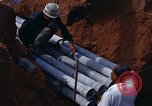 Image of laying pipes Thailand, 1966, second 24 stock footage video 65675042838