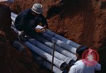 Image of laying pipes Thailand, 1966, second 25 stock footage video 65675042838