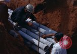 Image of laying pipes Thailand, 1966, second 26 stock footage video 65675042838
