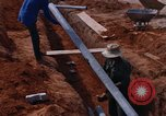 Image of laying pipes Thailand, 1966, second 33 stock footage video 65675042838