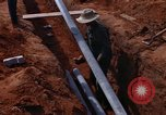 Image of laying pipes Thailand, 1966, second 34 stock footage video 65675042838