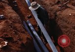Image of laying pipes Thailand, 1966, second 35 stock footage video 65675042838