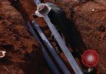 Image of laying pipes Thailand, 1966, second 36 stock footage video 65675042838