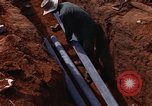 Image of laying pipes Thailand, 1966, second 37 stock footage video 65675042838