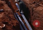 Image of laying pipes Thailand, 1966, second 38 stock footage video 65675042838