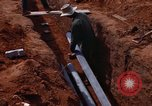 Image of laying pipes Thailand, 1966, second 39 stock footage video 65675042838