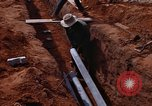 Image of laying pipes Thailand, 1966, second 40 stock footage video 65675042838