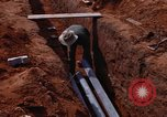 Image of laying pipes Thailand, 1966, second 41 stock footage video 65675042838