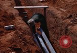 Image of laying pipes Thailand, 1966, second 42 stock footage video 65675042838