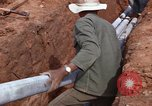 Image of laying pipes Thailand, 1966, second 44 stock footage video 65675042838