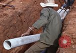Image of laying pipes Thailand, 1966, second 45 stock footage video 65675042838