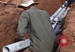Image of laying pipes Thailand, 1966, second 46 stock footage video 65675042838