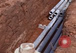 Image of laying pipes Thailand, 1966, second 50 stock footage video 65675042838