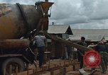 Image of mixing cement Thailand, 1966, second 10 stock footage video 65675042840