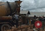 Image of mixing cement Thailand, 1966, second 12 stock footage video 65675042840