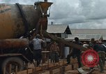 Image of mixing cement Thailand, 1966, second 16 stock footage video 65675042840