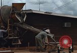 Image of mixing cement Thailand, 1966, second 21 stock footage video 65675042840