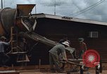 Image of mixing cement Thailand, 1966, second 23 stock footage video 65675042840