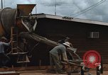 Image of mixing cement Thailand, 1966, second 25 stock footage video 65675042840