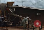 Image of mixing cement Thailand, 1966, second 26 stock footage video 65675042840