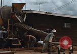Image of mixing cement Thailand, 1966, second 27 stock footage video 65675042840