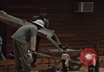 Image of mixing cement Thailand, 1966, second 30 stock footage video 65675042840