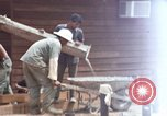 Image of mixing cement Thailand, 1966, second 38 stock footage video 65675042840