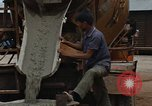 Image of mixing cement Thailand, 1966, second 52 stock footage video 65675042840