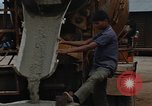 Image of mixing cement Thailand, 1966, second 53 stock footage video 65675042840