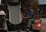 Image of mixing cement Thailand, 1966, second 60 stock footage video 65675042840