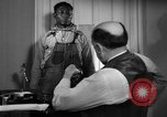 Image of Lead Belly United States USA, 1935, second 62 stock footage video 65675042911