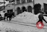 Image of shoveling snow Bludenz Austria, 1954, second 8 stock footage video 65675042927