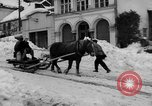 Image of shoveling snow Bludenz Austria, 1954, second 10 stock footage video 65675042927