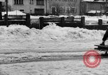 Image of shoveling snow Bludenz Austria, 1954, second 24 stock footage video 65675042927