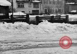 Image of shoveling snow Bludenz Austria, 1954, second 25 stock footage video 65675042927