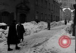 Image of shoveling snow Bludenz Austria, 1954, second 44 stock footage video 65675042927