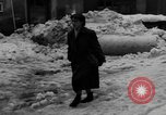 Image of shoveling snow Bludenz Austria, 1954, second 48 stock footage video 65675042927