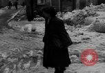 Image of shoveling snow Bludenz Austria, 1954, second 49 stock footage video 65675042927