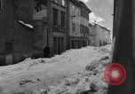 Image of shoveling snow Bludenz Austria, 1954, second 62 stock footage video 65675042927