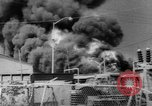 Image of Oil company warehouse under fire San Juan Puerto Rico, 1967, second 8 stock footage video 65675043046