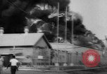 Image of Oil company warehouse under fire San Juan Puerto Rico, 1967, second 13 stock footage video 65675043046