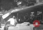 Image of Oil company warehouse under fire San Juan Puerto Rico, 1967, second 14 stock footage video 65675043046