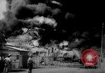 Image of Oil company warehouse under fire San Juan Puerto Rico, 1967, second 31 stock footage video 65675043046