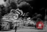 Image of Oil company warehouse under fire San Juan Puerto Rico, 1967, second 32 stock footage video 65675043046